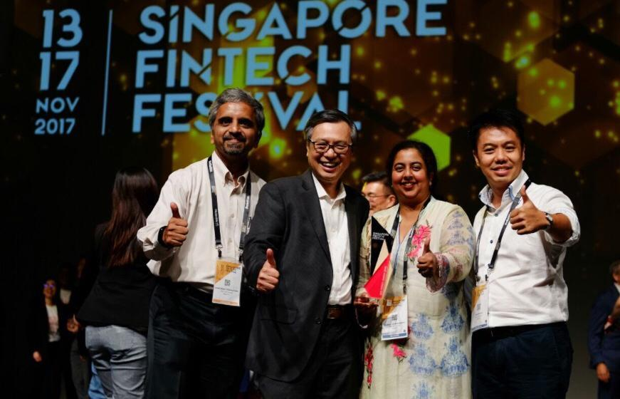 3 men and 1 woman collecting an award. AIDA Technologies won the MAS Fintech Award - AiDA Technologies