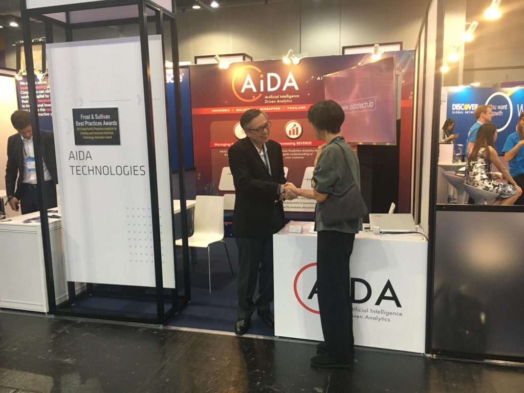 Dr. Geok Leng Tan, CEO of AIDA Technologies, greets a visitor at the Hong Kong Fintech Week exhibition - AiDA Technologies